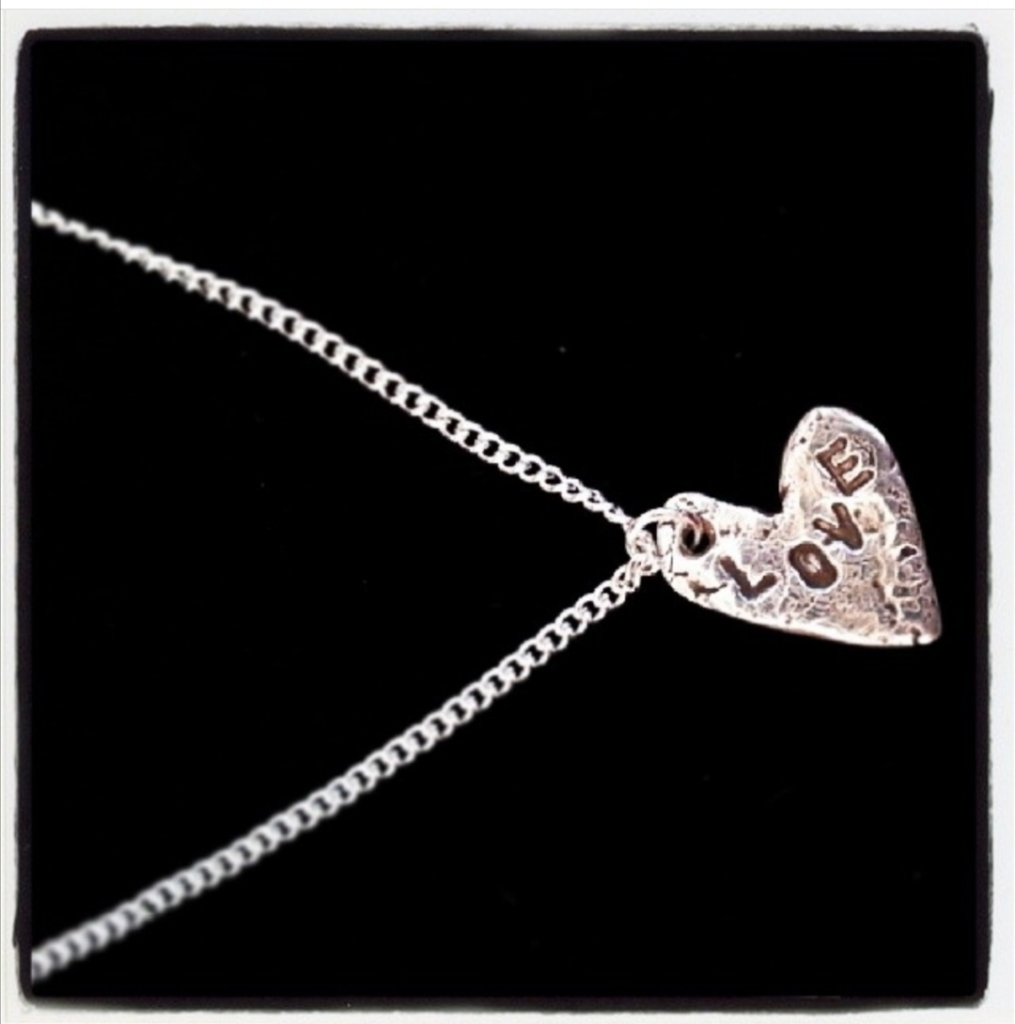 First Instagram post, silver heart necklace with LOVE stamped across