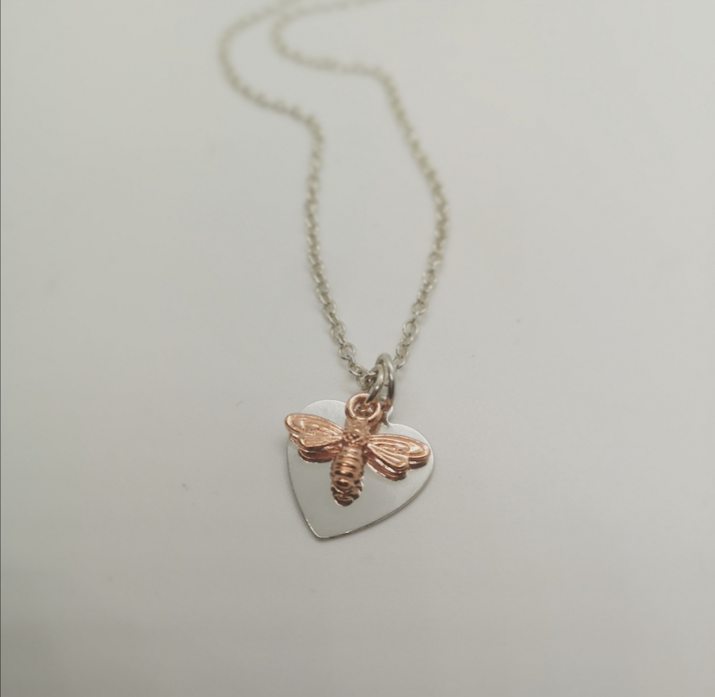 Silver heart and rose gold bee necklace